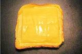 Шаг 2. На масло положить сыр плавленый.