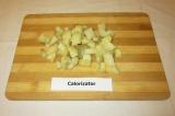 Шаг 1. Картофель отварить и нарезать кубиками.