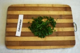 Шаг 8. Мелко порезать зелень. Добавить в суп, выключить и дать супу настояться