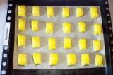 Шаг 11. Выложить на противень, смазать желтком, смешанным с молоком. Выпекать пр