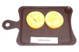 Шаг 5. Готовое филе выложить в половинки кожуры апельсина и залить соком, которы