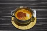 Шаг 5. Добавить рис, аджику и воду, тушить на среднем огне 15 минут под закрытой