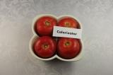 Шаг 7. Фаршированные помидоры переложить в жаропрочную форму, накрыть срезанными