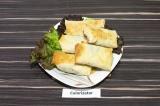 Готовое блюдо: ленивые пирожки из лаваша с картошкой