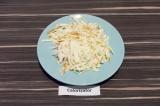 Шаг 1. Колбасный сыр натереть на терке.